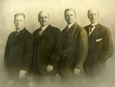 The first four Rotarians: Gustavus Loehr, Silvester Schiele, Hiram Shorey, and Paul P. Harris, circa 1905-1912.
